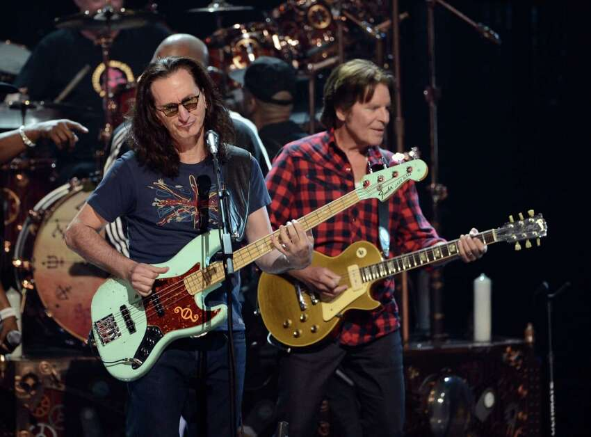 Inductee Geddy Lee and musician John Fogerty perform onstage at the 28th Annual Rock and Roll Hall of Fame Induction Ceremony at Nokia Theatre L.A. Live on April 18, 2013 in Los Angeles, California.