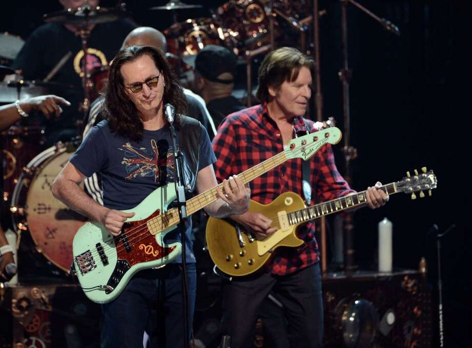 Inductee Geddy Lee and musician John Fogerty perform onstage at the 28th Annual Rock and Roll Hall of Fame Induction Ceremony at Nokia Theatre L.A. Live on April 18, 2013 in Los Angeles, California. Photo: Kevin Winter, Getty Images / 2013 Getty Images