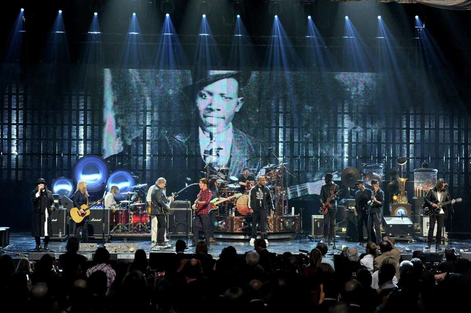 "(L-R) Inductees Ann Wilson and Nancy Wilson of Heart and Alex Lifeson of Rush, musicians Taylor Hawkins and Dave Grohl of Foo Fighters, inductees Neil Peart and Geddy Lee of Rush, MC Darryl ""D.M.C."" McDaniels, inductee Chuck D of Public Enemy and musicians Gary Clark Jr., Tom Morello and Chris Cornell perform onstage at the 28th Annual Rock and Roll Hall of Fame Induction Ceremony at Nokia Theatre L.A. Live on April 18, 2013 in Los Angeles, California. Photo: Kevin Winter, Getty Images / 2013 Getty Images"