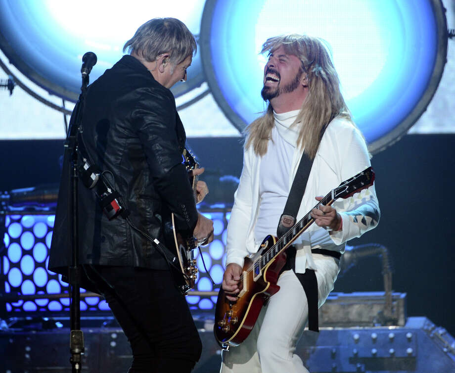 (L-R) Inductee Alex Lifeson of Rush and musician Dave Grohl of Foo Fighters perform onstage at the 28th Annual Rock and Roll Hall of Fame Induction Ceremony at Nokia Theatre L.A. Live on April 18, 2013 in Los Angeles, California. Photo: Kevin Winter, Getty Images / 2013 Getty Images