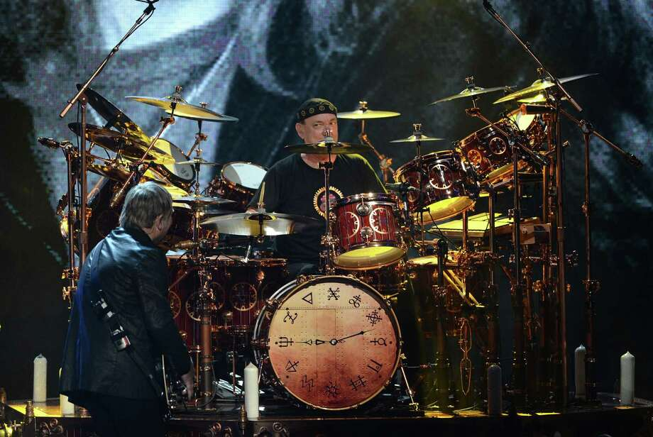 (L-R) Inductees Alex Lifeson and Neil Peart of Rush perform onstage at the 28th Annual Rock and Roll Hall of Fame Induction Ceremony at Nokia Theatre L.A. Live on April 18, 2013 in Los Angeles, California. Photo: Kevin Winter, Getty Images / 2013 Getty Images