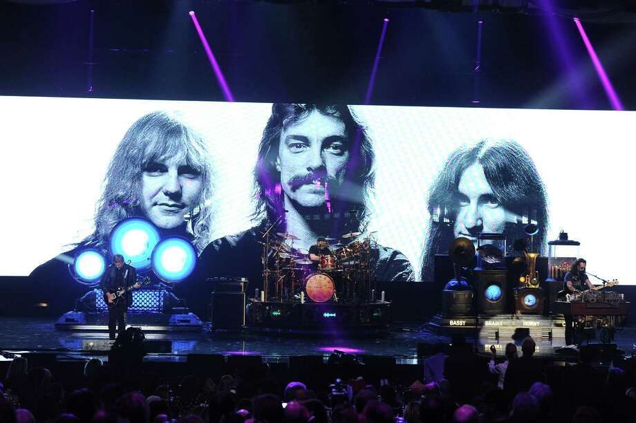 (L-R) Inductees Alex Lifeson, Neil Peart and Geddy Lee of Rush perform onstage at the 28th Annual Rock and Roll Hall of Fame Induction Ceremony at Nokia Theatre L.A. Live on April 18, 2013 in Los Angeles, California. Photo: Kevin Winter, Getty Images / 2013 Getty Images