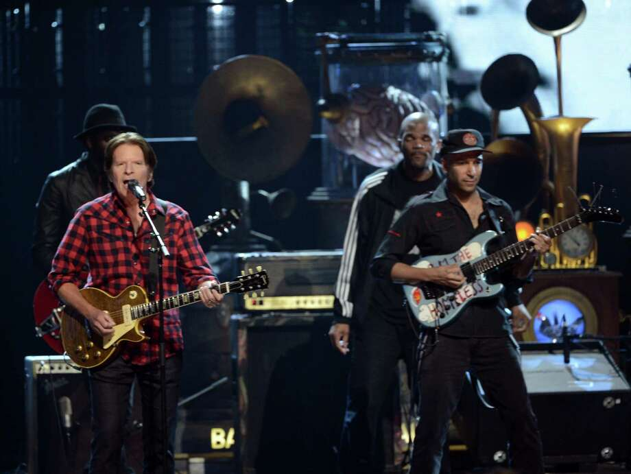 (L-R) Musicians John Fogerty, Darryl 'D.M.C.' McDaniels, and Tom Morello perform  on stage at the 28th Annual Rock and Roll Hall of Fame Induction Ceremony at Nokia Theatre L.A. Live on April 18, 2013 in Los Angeles, California. Photo: Kevin Winter, Getty Images / 2013 Getty Images