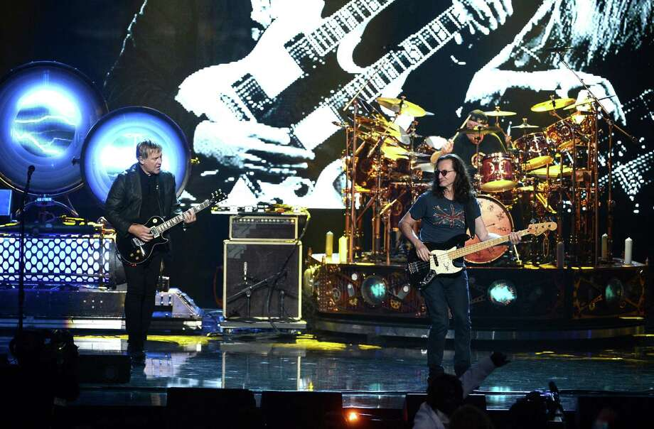 Inductees Alex Lifeson and Geddy Lee of Rush perform on stage at the 28th Annual Rock and Roll Hall of Fame Induction Ceremony at Nokia Theatre L.A. Live on April 18, 2013 in Los Angeles, California. Photo: Kevin Winter, Getty Images / 2013 Getty Images