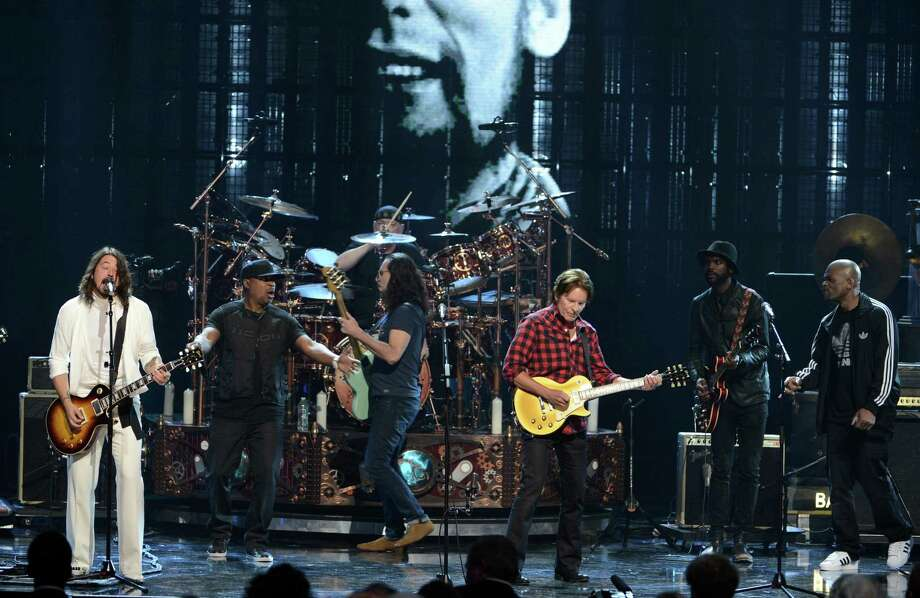 "(L-R) Musician Dave Grohl, inductees Chuck D of Public Enemy and Geddy Lee and Neil Peart of Rush and musicians John Fogerty, Gary Clark Jr. and Darryl ""D.M.C."" McDaniels perform onstage at the 28th Annual Rock and Roll Hall of Fame Induction Ceremony at Nokia Theatre L.A. Live on April 18, 2013 in Los Angeles, California. Photo: Kevin Winter, Getty Images / 2013 Getty Images"