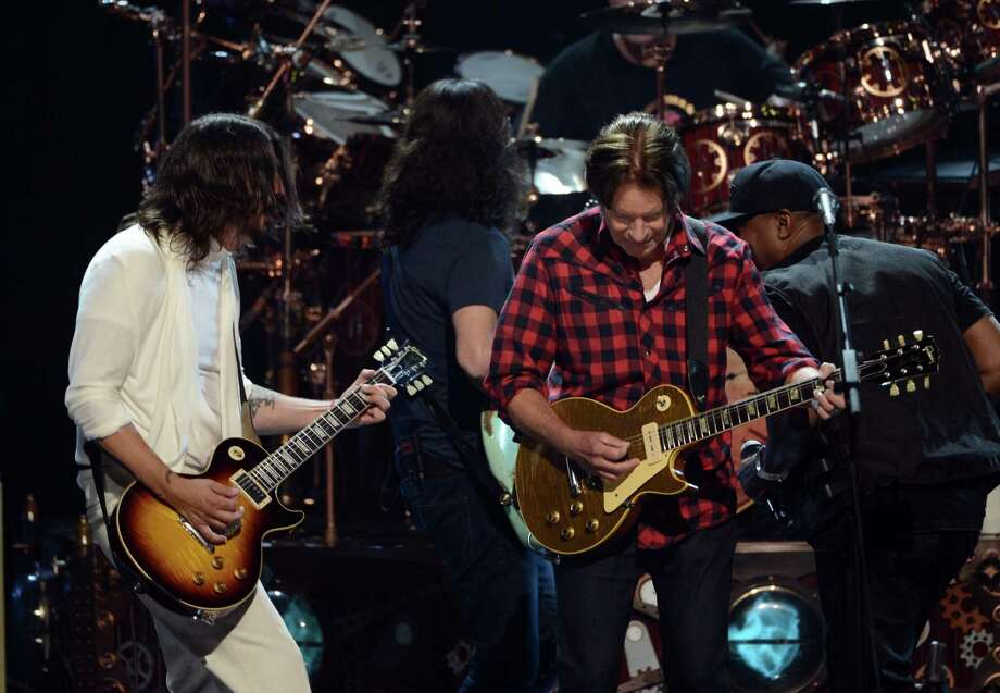 (L-R) Musicians Dave Grohl and John Fogerty and inductee Chuck D of Public Enemy perform onstage at the 28th Annual Rock and Roll Hall of Fame Induction Ceremony at Nokia Theatre L.A. Live on April 18, 2013 in Los Angeles, California. Photo: Kevin Winter, Getty Images / 2013 Getty Images