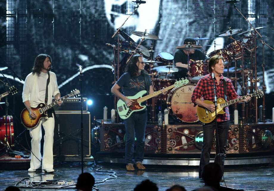 (L-R) Musician Dave Grohl of Foo Fighters, inductees Geddy Lee and Neil Peart of Rush and musician John Fogerty perform onstage at the 28th Annual Rock and Roll Hall of Fame Induction Ceremony at Nokia Theatre L.A. Live on April 18, 2013 in Los Angeles, California. Photo: Kevin Winter, Getty Images / 2013 Getty Images