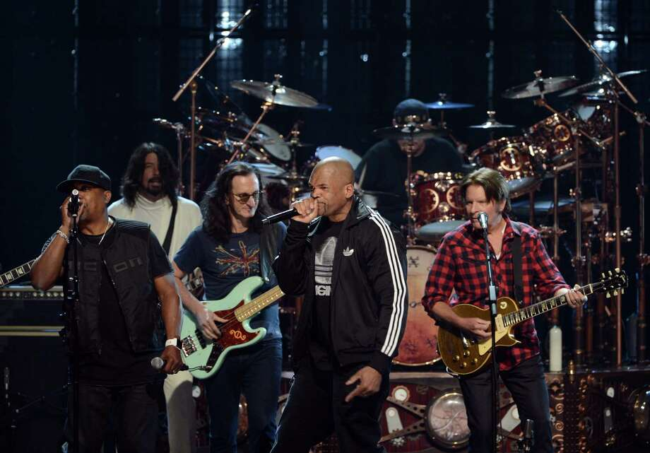 "(L-R) Inductee Chuck D of Public Enemy, musician Dave Grohl, inductee Geddy Lee of Rush, Darryl ""D.M.C."" McDaniels, inductee Neil Peart of Rush and musician John Fogerty perform onstage at the 28th Annual Rock and Roll Hall of Fame Induction Ceremony at Nokia Theatre L.A. Live on April 18, 2013 in Los Angeles, California. Photo: Kevin Winter, Getty Images / 2013 Getty Images"