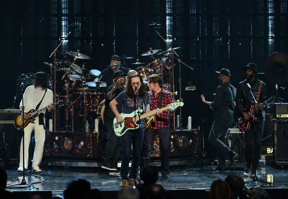 (L-R) Musician Dave Grohl, inductees Neil Peart of Rush, Chuck D of Public Enemy, Geddy Lee of Rush and musicians John Fogerty, Tom Morello and Gary Clark Jr. perform onstage at the 28th Annual Rock and Roll Hall of Fame Induction Ceremony at Nokia Theatre L.A. Live on April 18, 2013 in Los Angeles, California. Photo: Kevin Winter, Getty Images / 2013 Getty Images