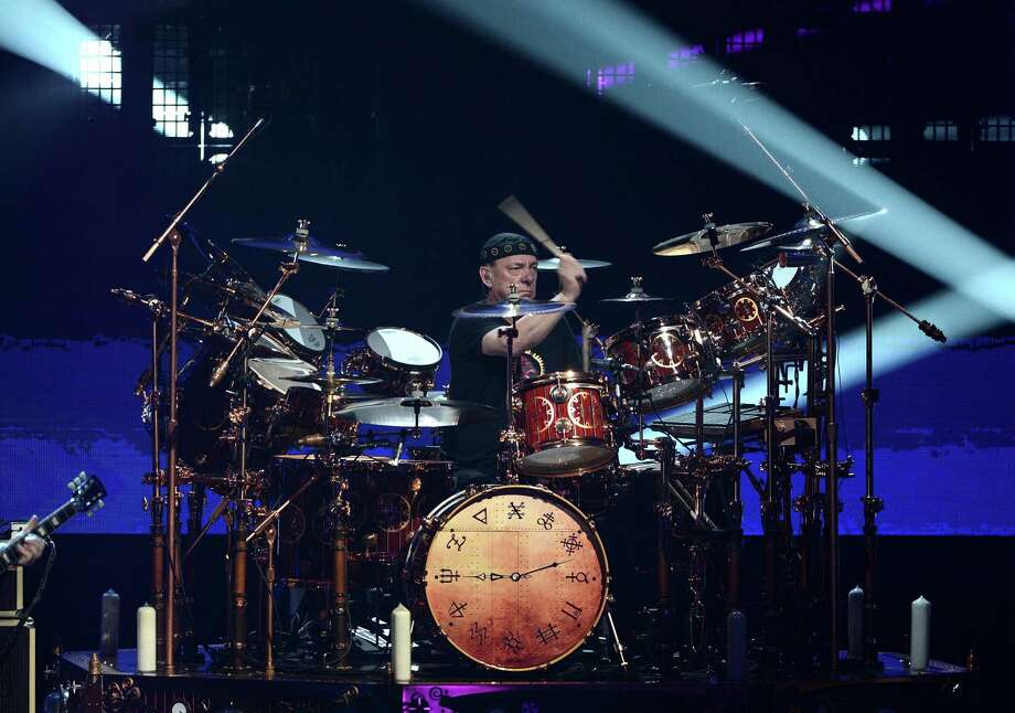 Musician Neil Peart of Rush perform on stage at the 28th Annual Rock and Roll Hall of Fame Induction Ceremony at Nokia Theatre L.A. Live on April 18, 2013 in Los Angeles, California. Photo: Kevin Winter, Getty Images / 2013 Getty Images