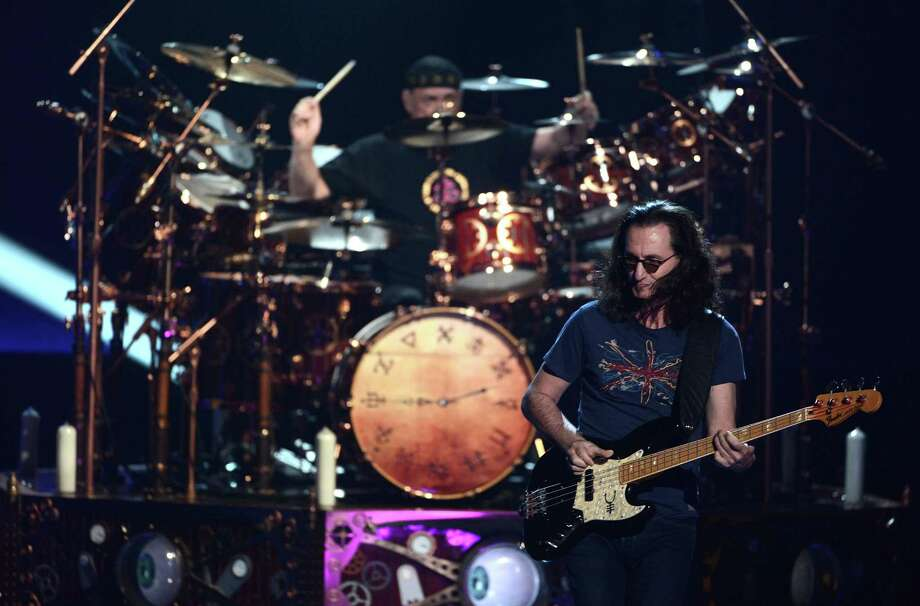 Musicians Neil Peart (L) and Geddy Lee of Rush perform on stage at the 28th Annual Rock and Roll Hall of Fame Induction Ceremony at Nokia Theatre L.A. Live on April 18, 2013 in Los Angeles, California. Photo: Kevin Winter, Getty Images / 2013 Getty Images