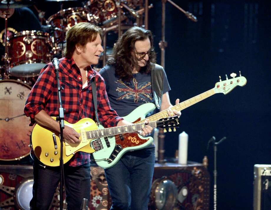 Musician John Fogerty (L) and  Inductee Geddy Lee perform onstage at the 28th Annual Rock and Roll Hall of Fame Induction Ceremony at Nokia Theatre L.A. Live on April 18, 2013 in Los Angeles, California. Photo: Kevin Winter, Getty Images / 2013 Getty Images