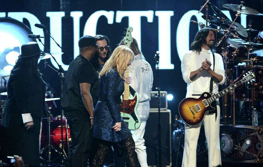 (L-R) Inductees Ann Wilson of Heart, Chuck D of Public Enemy, Geddy Lee of Rush and Nancy Wilson of Heart and musicians Taylor Hawkins and Dave Grohl of Foo Fighters perform onstage at the 28th Annual Rock and Roll Hall of Fame Induction Ceremony at Nokia Theatre L.A. Live on April 18, 2013 in Los Angeles, California. Photo: Kevin Winter, Getty Images / 2013 Getty Images