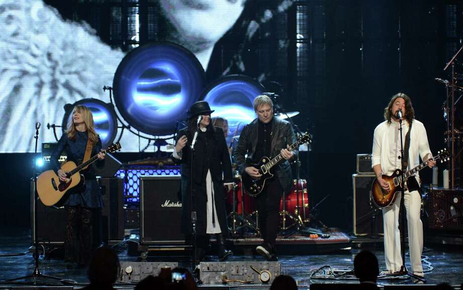 (L-R) Inductees Nancy Wilson and Ann Wilson of Heart, Alex Lifeson of Rush and musician Dave Grohl perform onstage at the 28th Annual Rock and Roll Hall of Fame Induction Ceremony at Nokia Theatre L.A. Live on April 18, 2013 in Los Angeles, California. Photo: Kevin Winter, Getty Images / 2013 Getty Images