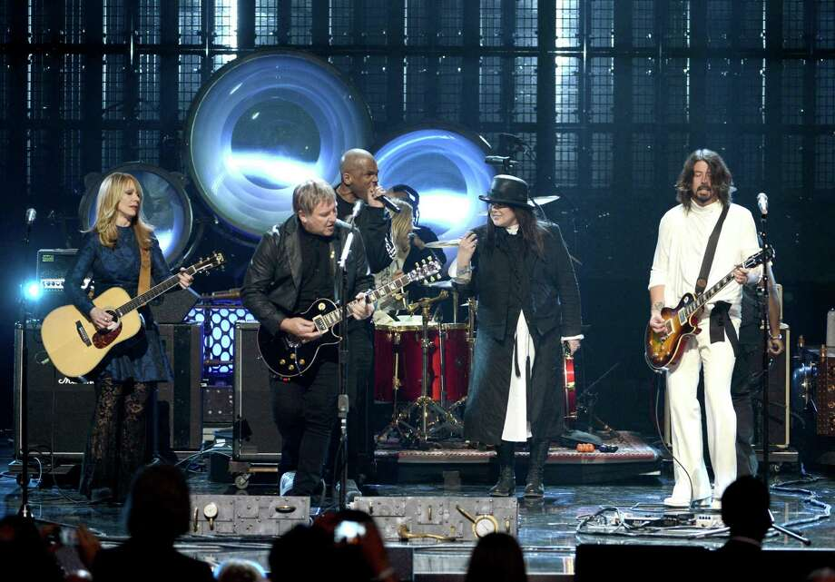 "(L-R) Inductees Nancy Wilson of Heart, Alex Lifeson of Rush, Darryl ""D.M.C."" McDaniels, inductee Ann Wilson of Heart and musician Dave Grohl perform onstage at the 28th Annual Rock and Roll Hall of Fame Induction Ceremony at Nokia Theatre L.A. Live on April 18, 2013 in Los Angeles, California. Photo: Kevin Winter, Getty Images / 2013 Getty Images"