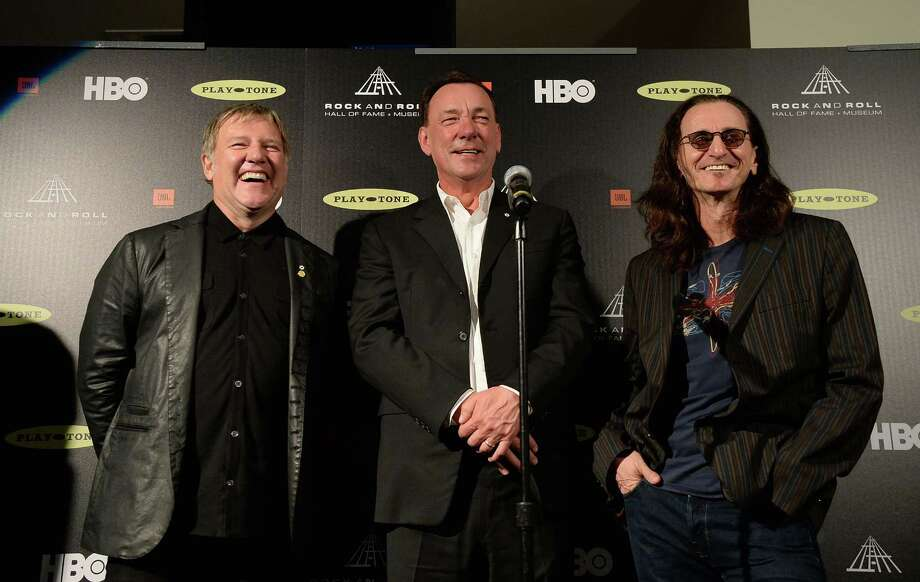 (L-R) Inductees Alex Lifeson, Neil Peart, and Geddy Lee pose in the press room at the 28th Annual Rock and Roll Hall of Fame Induction Ceremony at Nokia Theatre L.A. Live on April 18, 2013 in Los Angeles, California. Photo: Jason Merritt, Getty Images / 2013 Getty Images