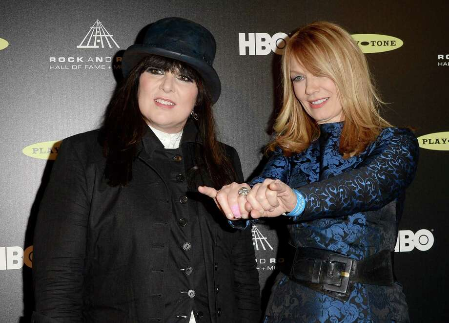 Inductees Ann Wilson (L) and Nancy Wilson of Heart pose in the press room at the 28th Annual Rock and Roll Hall of Fame Induction Ceremony at Nokia Theatre L.A. Live on April 18, 2013 in Los Angeles, California. Photo: Jason Merritt, Getty Images / 2013 Getty Images