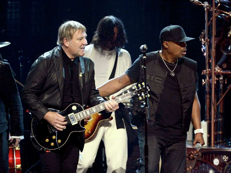 (L-R) Inductee Alex Lifeson of Rush, musician Dave Grohl and inductee Chuck D of Public Enemy perform onstage at the 28th Annual Rock and Roll Hall of Fame Induction Ceremony at Nokia Theatre L.A. Live on April 18, 2013 in Los Angeles, California. Photo: Kevin Winter, Getty Images / 2013 Getty Images