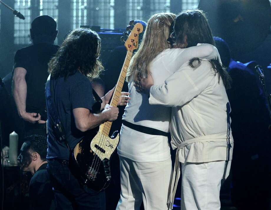 LOS ANGELES, CA - APRIL 18: (L-R) Musicians Dave Grohl and Nick Raskulinecz perform on stage at the 28th Annual Rock and Roll Hall of Fame Induction Ceremony at Nokia Theatre L.A. Live on April 18, 2013 in Los Angeles, California. Photo: Kevin Winter, Getty Images / 2013 Getty Images