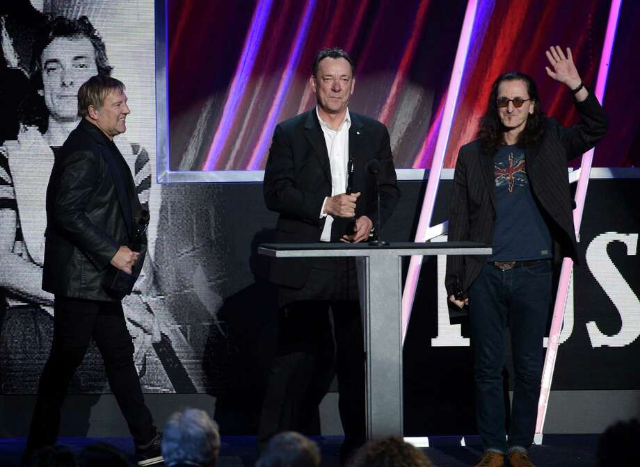 LOS ANGELES, CA - APRIL 18: (L-R) Inductees Alex Lifeson, Neil Peart and Geddy Lee of Rush speak onstage at the 28th Annual Rock and Roll Hall of Fame Induction Ceremony at Nokia Theatre L.A. Live on April 18, 2013 in Los Angeles, California. Photo: Kevin Winter, Getty Images / 2013 Getty Images