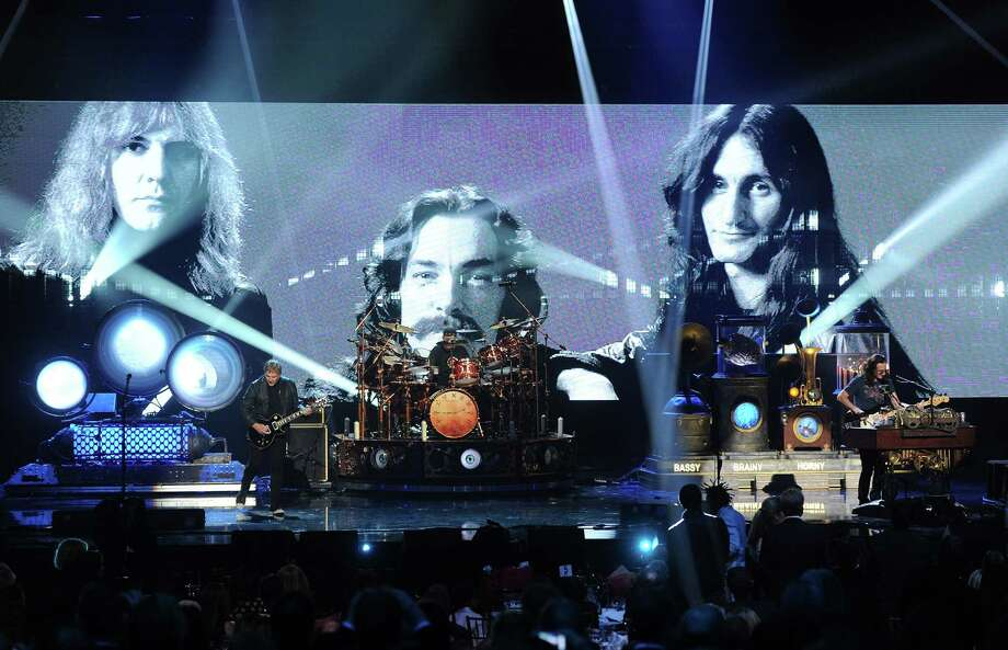 LOS ANGELES, CA - APRIL 18:  (L-R) Inductee Alex Lifeson, Neil Peart, and Geddy Lee of Rush perform on stage at the 28th Annual Rock and Roll Hall of Fame Induction Ceremony at Nokia Theatre L.A. Live on April 18, 2013 in Los Angeles, California. Photo: Kevin Winter, Getty Images / 2013 Getty Images