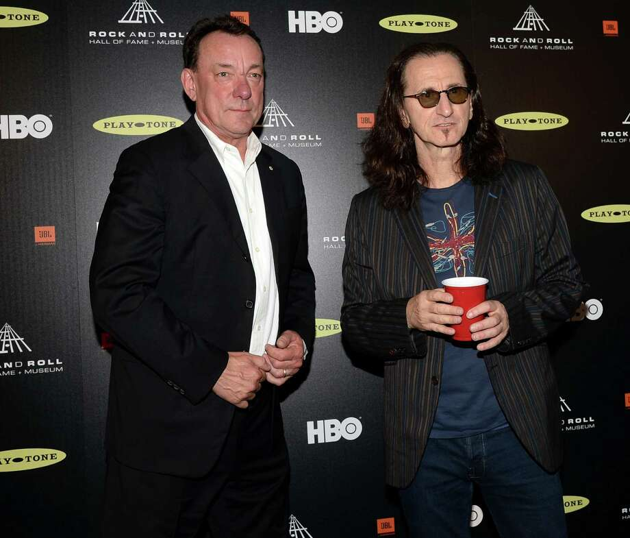 LOS ANGELES, CA - APRIL 18: Inductees Neil Peart (L) and Geddy Lee of Rush pose in the press room at the 28th Annual Rock and Roll Hall of Fame Induction Ceremony at Nokia Theatre L.A. Live on April 18, 2013 in Los Angeles, California. Photo: Jason Merritt, Getty Images / 2013 Getty Images
