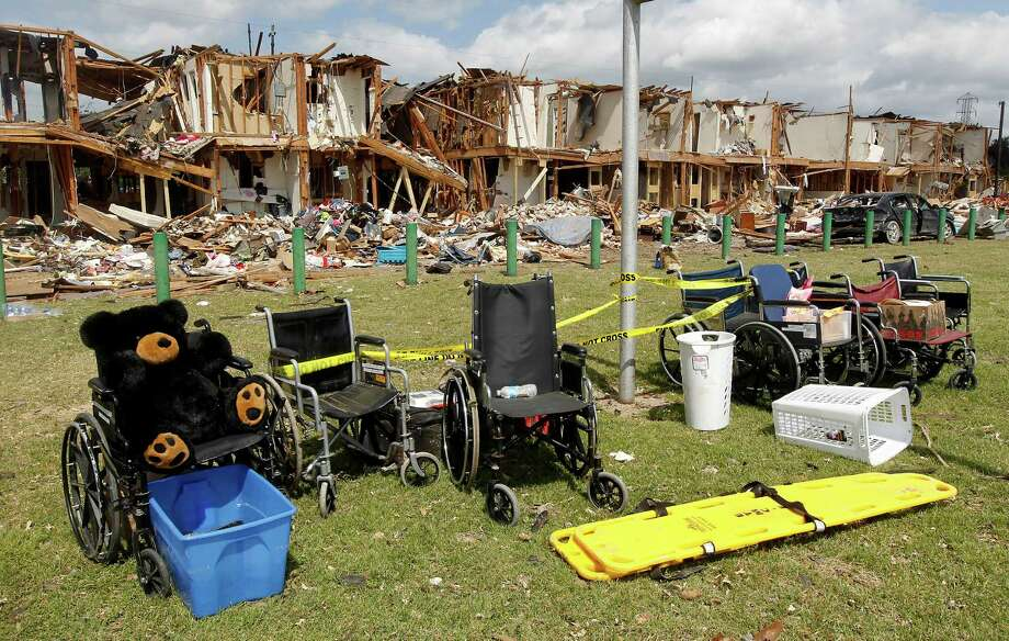 Wheelchairs are seen outside a damaged apartment complex Sunday, April 21, 2013, four days after an explosion at a fertilizer plant in West, Texas. The massive explosion at the West Fertilizer Co. Wednesday night killed 14 people and injured more than 160. (AP Photo/Dallas Morning News, Michael Ainsworth, pool) Photo: Michael Ainsworth, Associated Press / Pool The Dallas Morning News