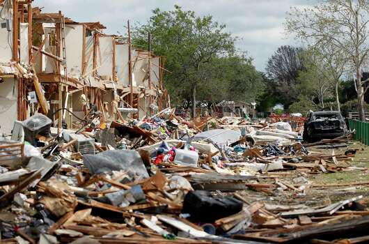 A damaged apartment complex is seen Sunday, April 21, 2013, four days after an explosion at a fertilizer plant in West, Texas. The massive explosion at the West Fertilizer Co. Wednesday night killed 14 people and injured more than 160. (AP Photo/The Dallas Morning News, Michael Ainsworth, Pool) Photo: Michael Ainsworth, Associated Press / Pool The Dallas Morning News