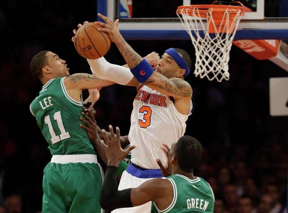 New York Knicks forward Kenyon Martin (3) grabs a rebound against Boston Celtics guard Courtney Lee (11) and forward Jeff Green during the second half of Game 1 of in the first round of the NBA basketball playoffs in New York, Saturday, April 20, 2013. The Knicks win 85-78. Photo: Kathy Willens