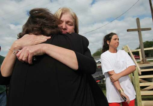 Theresa Sparks embraces a friend after the First Baptist Church West outdoor Sunday service for the first time since the plant explosion on Sunday, April 21, 2013, in West. Photo: Mayra Beltran, Houston Chronicle / © 2013 Houston Chronicle