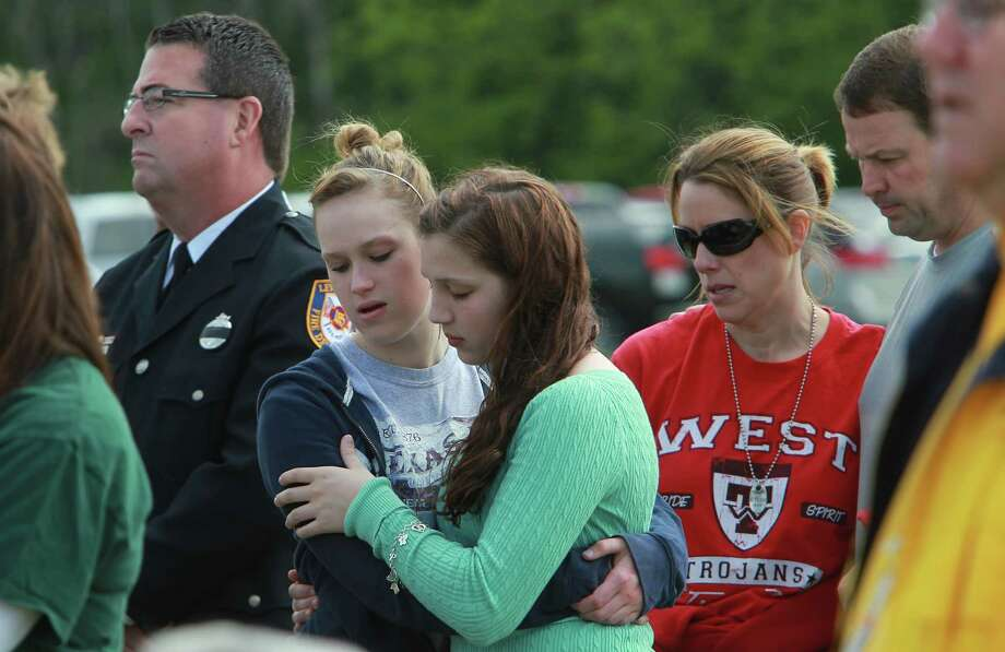 Presley Landrum embraces sister Payton Landrum during the First Baptist Church West outdoor prayer service for the first time since the plant explosion on Sunday, April 21, 2013, in West. Photo: Mayra Beltran, Houston Chronicle / © 2013 Houston Chronicle