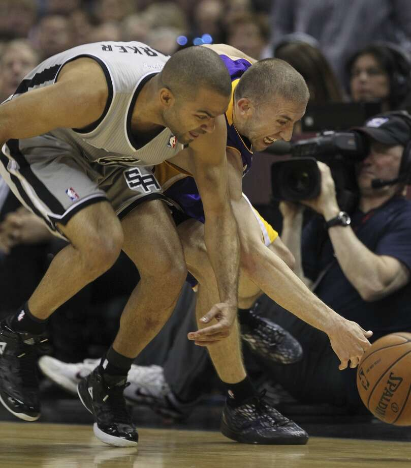 The Spurs\' Tony Parker scrambles for a loose ball against Los Angeles Lakers\' Steve Blake during the first half of Game 1 in the first round of the NBA Playoffs at the AT&T Center, Sunday, April 21, 2013.
