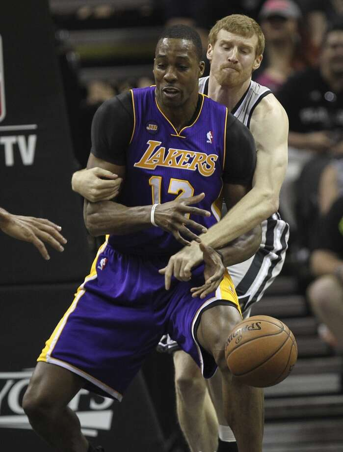 The Spurs\' Matt Bonner fouls Los Angeles Lakers\' Dwight Howard during the first half of Game 1 in the first round of the 0layoffs at the AT&T Center, Sunday, April 21, 2013.