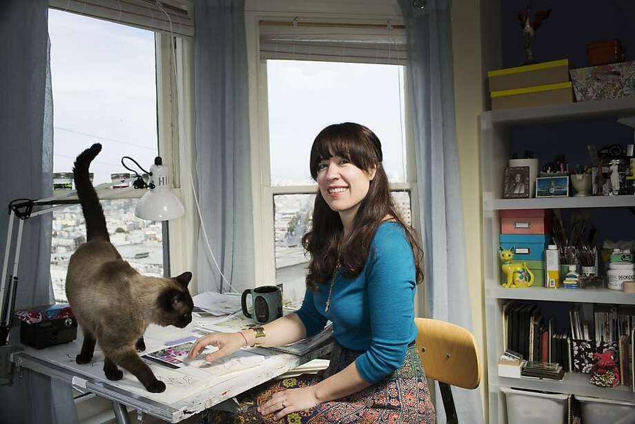 Colette Clark, founder of removable wallpaper company Timothy Sue, in her Bernal Heights home with her cat Raj. Inset below: One of her bright and bold patterns. Photo: Stephen Lam, Special To The Chronicle