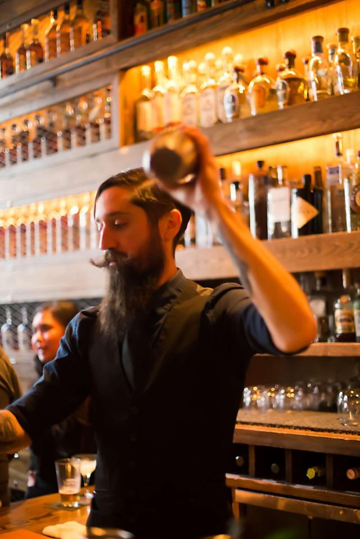 Rickhouse bartender Louis Santucci shakes up a cocktail.