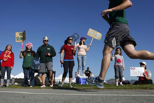 employees of the presidio sports basement encourage runners near the