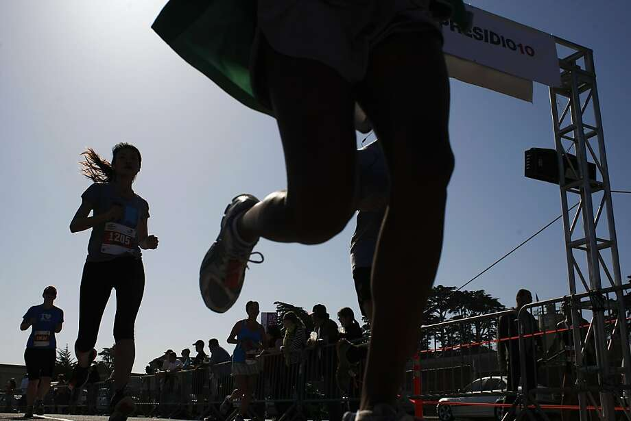 Marathon participants cross the finish line after the Presidio 10k on Sunday, April 21 2013. The Presidio 10k supports the Guardsman Charity each year. Photo: James Tensuan, The Chronicle