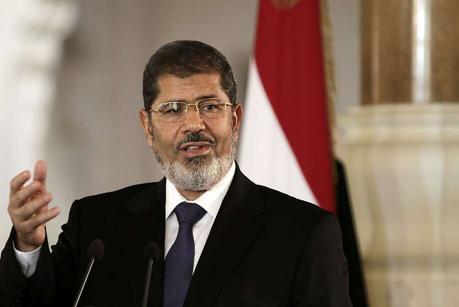FILE - In this Friday, July 13, 2012 file photo, Egyptian President Mohammed Morsi holds a joint news conference with Tunisian President Moncef Marzouki, unseen, at the Presidential palace in Cairo, Egypt. In a posting Saturday, April 20, 2013 on his official Twitter account, Morsi promised to reshuffle the Cabinet and appoint new governors. (AP Photo/Maya Alleruzzo, File) Photo: Maya Alleruzzo, Associated Press