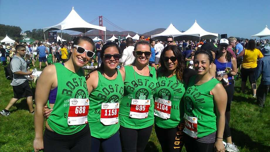 Noelle Leon-Guerrero (left) organized five co-workers from a Ernst & Young, an SF accounting firm, to wear Celtics jerseys for the Presidio 10 Sunday.  At the finish line are: l to r Guerrero, Claudia sun, nicole Likow, Julia Silvestre, Catrina Miranda. Photo: Sam Whiting, Sf Chronicle