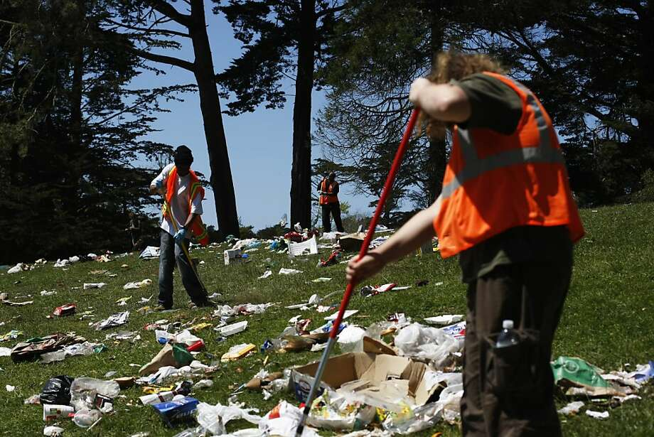Workers clear garbage from Hippie Hill in Golden Gate park after the unofficial 4/20 marijuana celebration. Photo: James Tensuan, The Chronicle