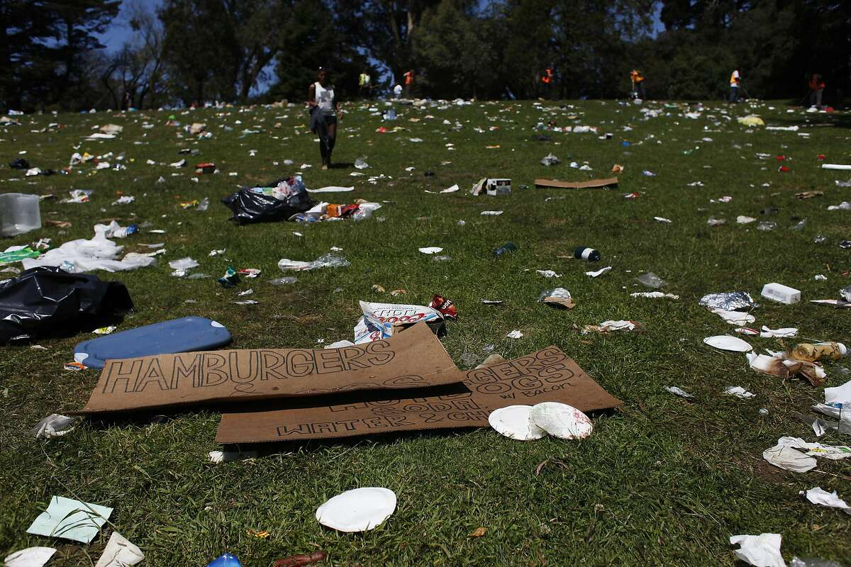Workers clean up Hippie Hill in Golden Gate Park on Sunday, April 21. 420 participants left thousands of pounds of garbage in Golden Gate Park after the day's festivities.