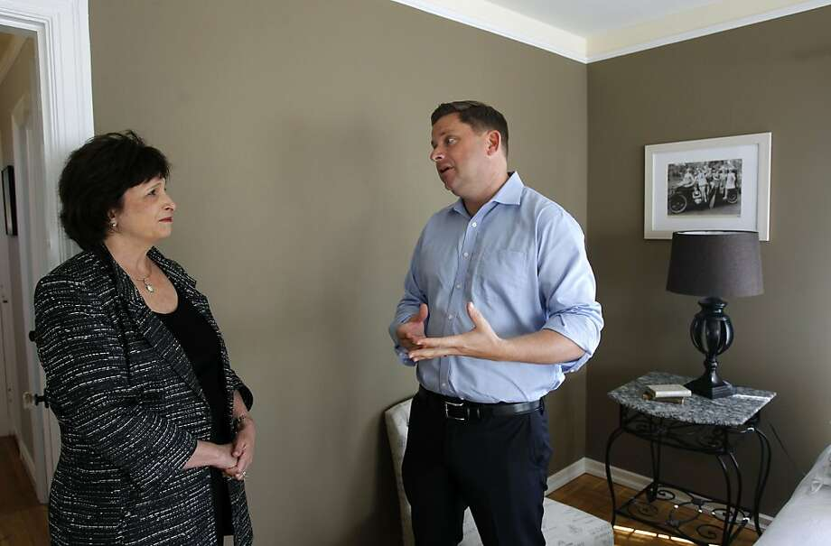 Real estate agent Carrie Du Bois and Bob Bredel visit an open house in the test-score-crazy home market. Photo: Paul Chinn, The Chronicle