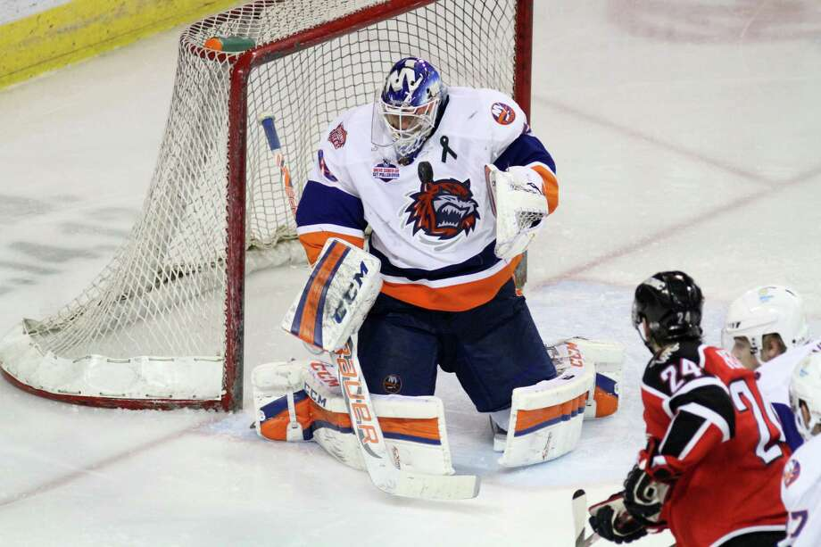 Sound Tigers goalie Anders Nilsson, 45, blocks a shot in the third period in a game against the Portland Pirates at the Webster Bank Arena in Bridgeport, Conn., on Sunday, April 21, 2013. Photo: BK Angeletti, B.K. Angeletti / Connecticut Post freelance B.K. Angeletti