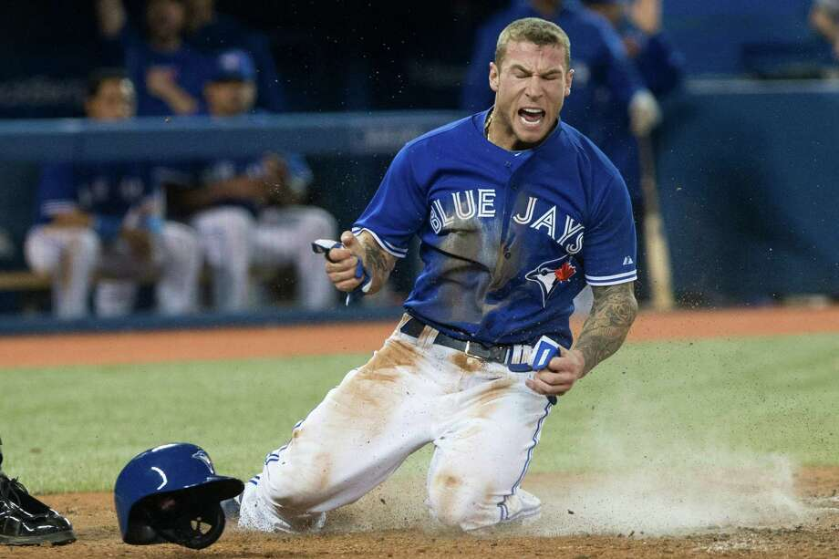 Toronto Blue Jays Brett Lawrie reacts at home plate after scoring on a single by Melky Cabrera off New York Yankees pitcher David Phelps during sixth inning MLB American League baseball action in Toronto on Sunday April 21, 2013. (AP Photo/THE CANADIAN PRESS,Chris Young) Photo: Chris Young