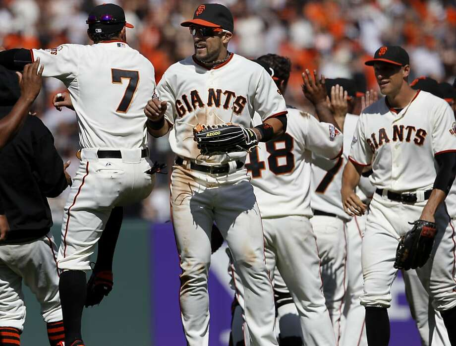 Andres Torres and Gregor Blanco (7) celebrated the Giants victory as they left the field. The San Francisco Giants versus the San Diego Padres Sunday April 21, 2013 at AT&T park in San Francisco, Calif. Photo: Brant Ward, The Chronicle
