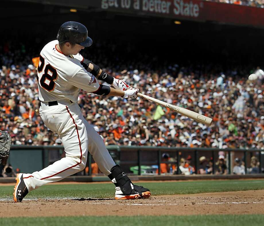 Buster Posey hit a two run homer in the fifth inning off Padres starter Eric Stults. The San Francisco Giants versus the San Diego Padres Sunday April 21, 2013 at AT&T park in San Francisco, Calif. Photo: Brant Ward, The Chronicle