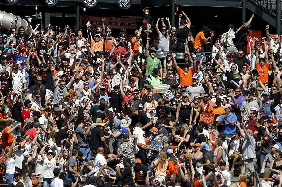 The crowd celebrates Buster Poseys home run in the fifth inning. The San Francisco Giants versus the San Diego Padres Sunday April 21, 2013 at AT&T park in San Francisco, Calif. Photo: Brant Ward, The Chronicle