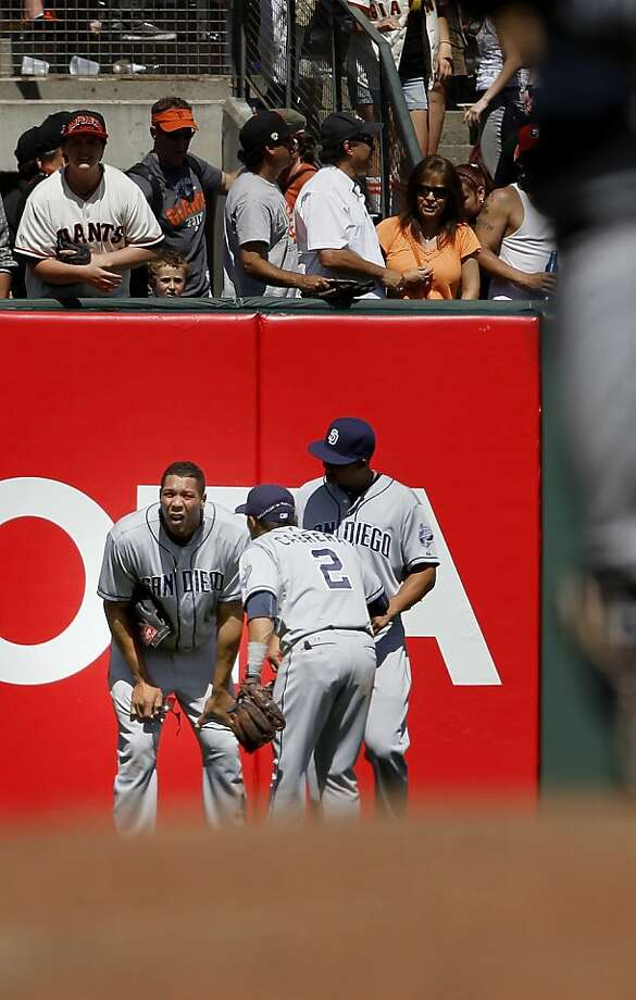 Padres left fielder Kyle Banks (left) is joined by teammates after a catch he made against the wall on a hit by Joaquin Arias. The San Francisco Giants versus the San Diego Padres Sunday April 21, 2013 at AT&T park in San Francisco, Calif. Photo: Brant Ward, The Chronicle