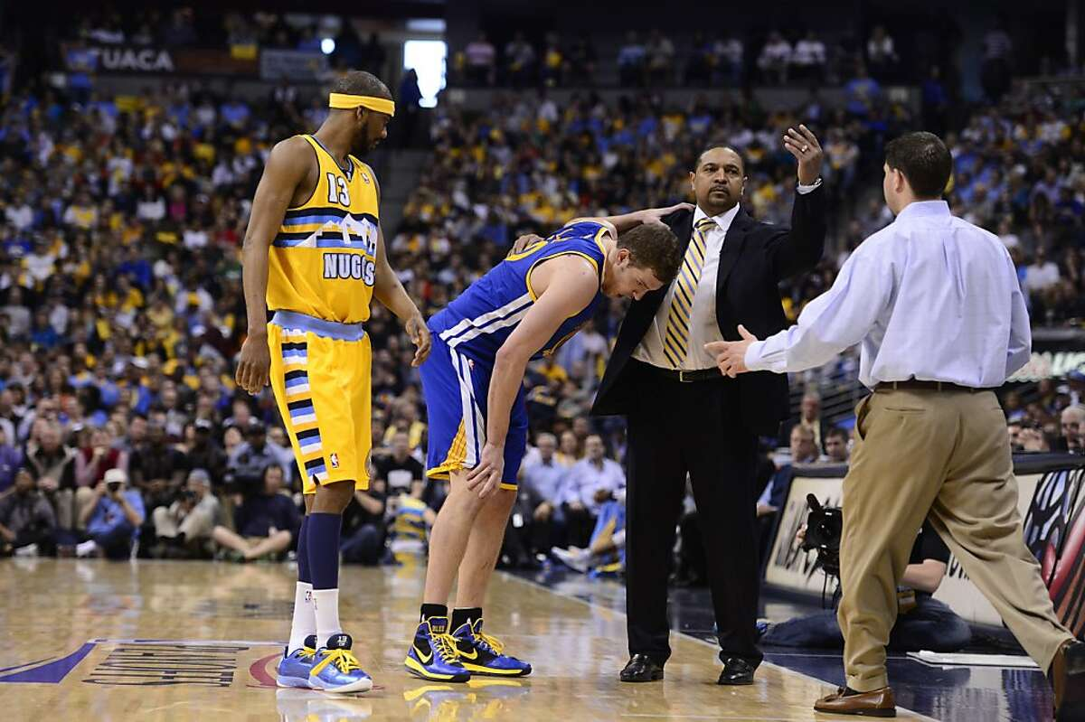 DENVER, CO. - APRIL 20: Golden State Warriors power forward David Lee (10) leaves the court after getting hurt. The Denver Nuggets took on the Golden State Warriors in Game 1 of the Western Conference First Round Series at the Pepsi Center in Denver, Colo. on April 20, 2013. (Photo by AAron Ontiveroz/The Denver Post)