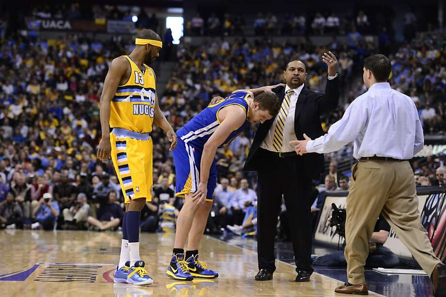 Warriors head coach Mark Jackson calls for help after a hip injury knocked David Lee out of Game 1 - and the series. Photo: AAron Ontiveroz, DP